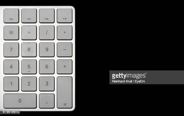 Close-Up Of Computer Keyboard Over Black Background