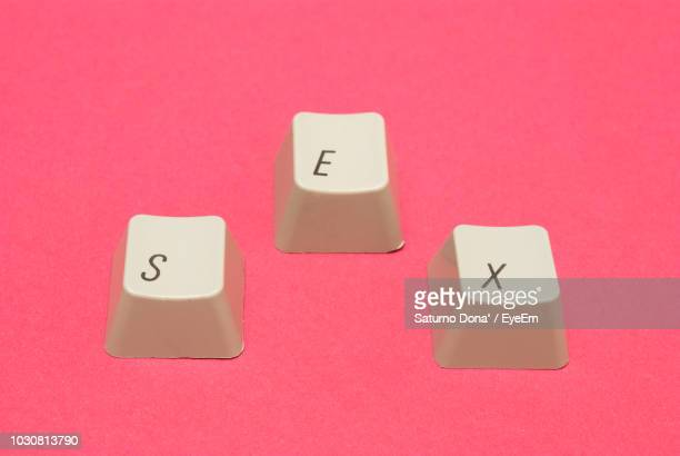 close-up of computer keyboards on pink background - datortangent bildbanksfoton och bilder