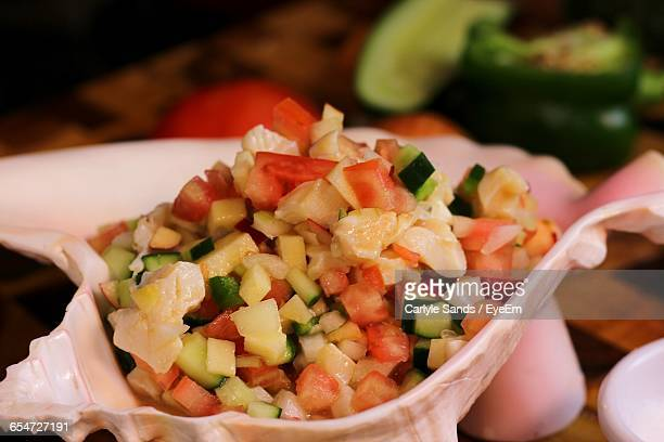 close-up of conch salad - conch shell stock pictures, royalty-free photos & images