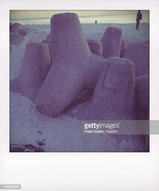 close-up of concrete blocks on beach - frank swertz stockfoto's en -beelden
