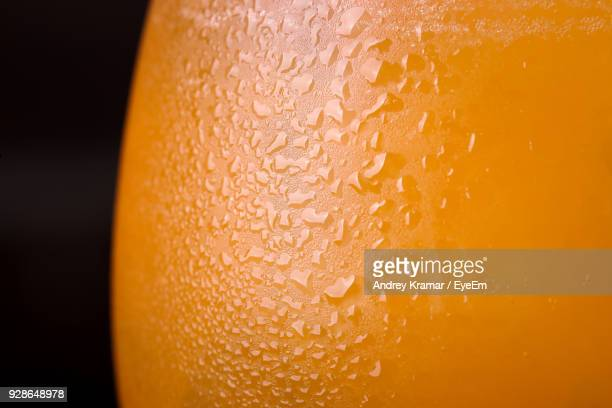 Close-Up Of Condensation On Glass With Orange Drink
