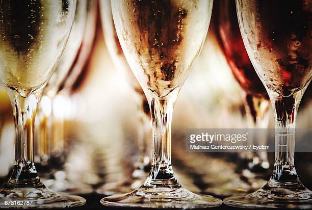 Close-Up Of Condensed Champagne Flutes Arranged On Table