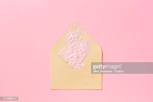 close-up of confetti over pink background - alina stock pictures, royalty-free photos & images