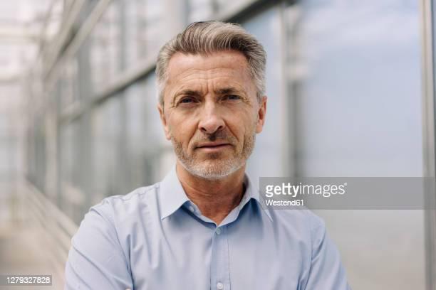 close-up of confident male professional in plant nursery - 50 54 jahre stock-fotos und bilder