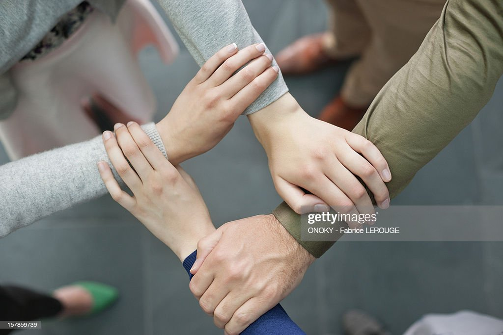 Close-up of connecting hands of business executives : Stock Photo