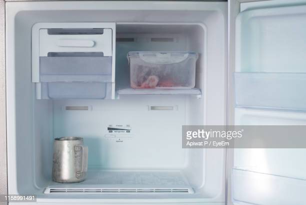 close-up of container in refrigerator at home - 冷凍庫 ストックフォトと画像