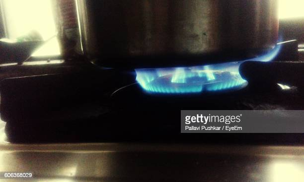 Close-Up Of Container On Gas Stove Burner In Kitchen