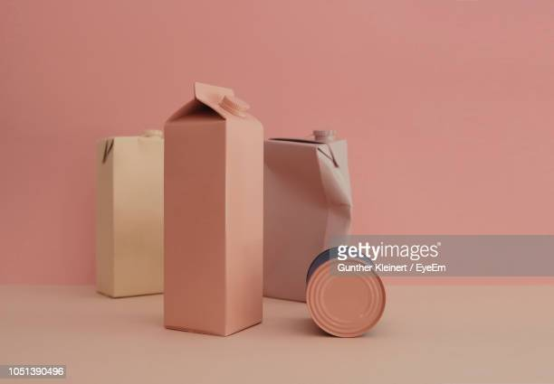 close-up of containers on table against wall - still life not people stock photos and pictures