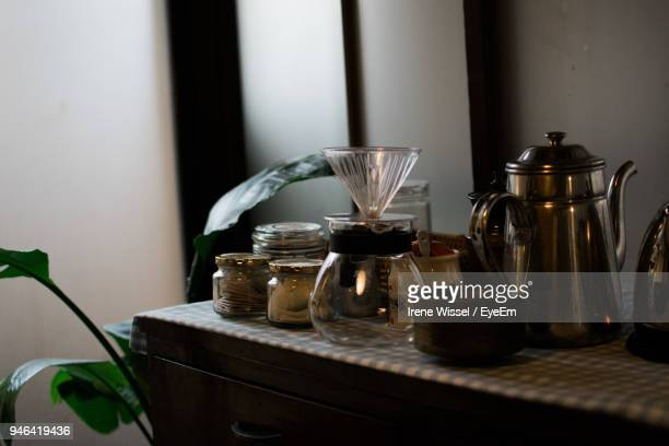 close-up of containers on table at home - やかん ストックフォトと画像