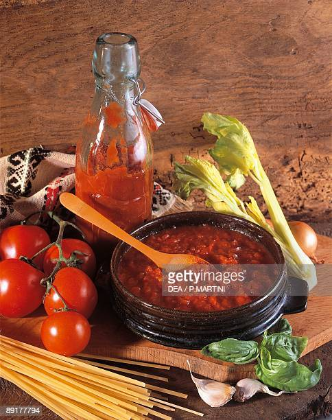Closeup of cooked tomato sauce with fresh tomatoes