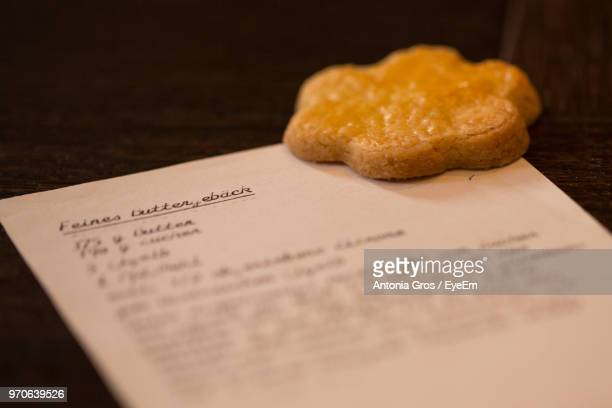 Close-Up Of Cookie With Paper On Table