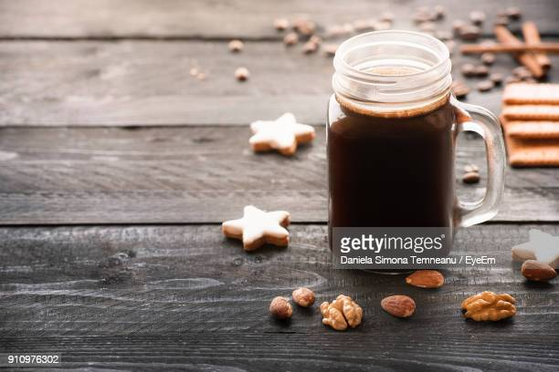 Close-Up Of Cookies And Drink On Table