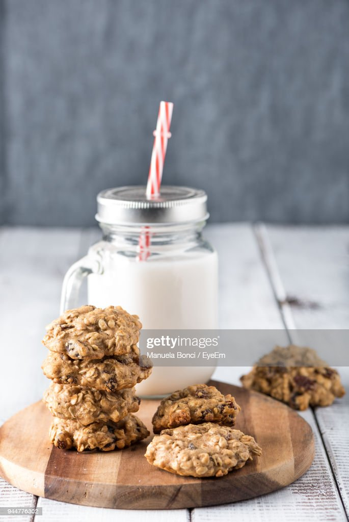Close-Up Of Cookies By Mason Jar On Table : Stock Photo