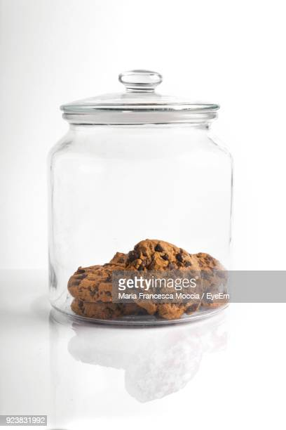 Close-Up Of Cookies In Jar Against White Background