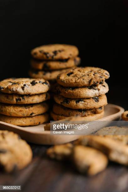 Close-up of cookies in tray on table against black background