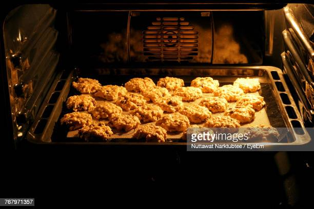close-up of cookies on baking sheet in oven - baking sheet stock pictures, royalty-free photos & images