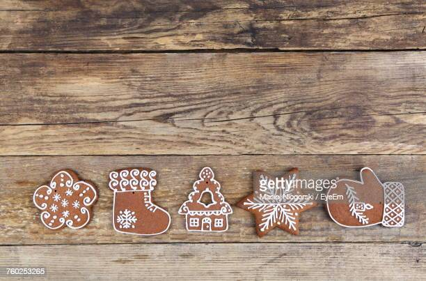close-up of cookies on table - gingerbread cookie stock pictures, royalty-free photos & images
