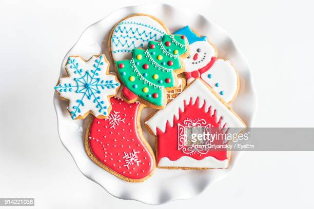 close-up of cookies on white background - christmas cookies stock pictures, royalty-free photos & images