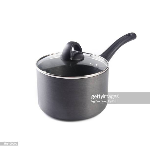 close-up of cooking pan against white background - saucepan stock pictures, royalty-free photos & images