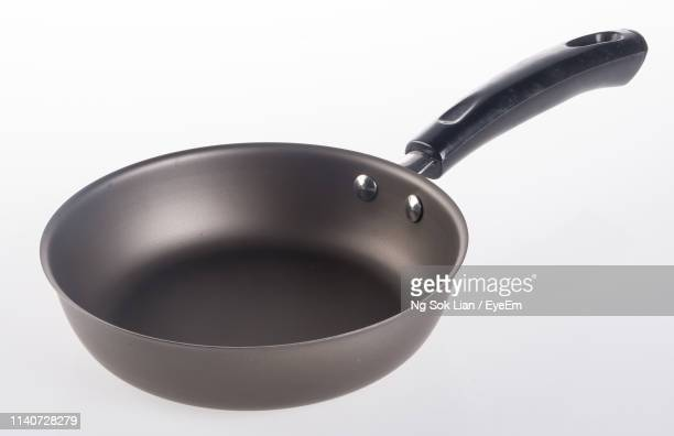 close-up of cooking pan over white background - saucepan stock pictures, royalty-free photos & images