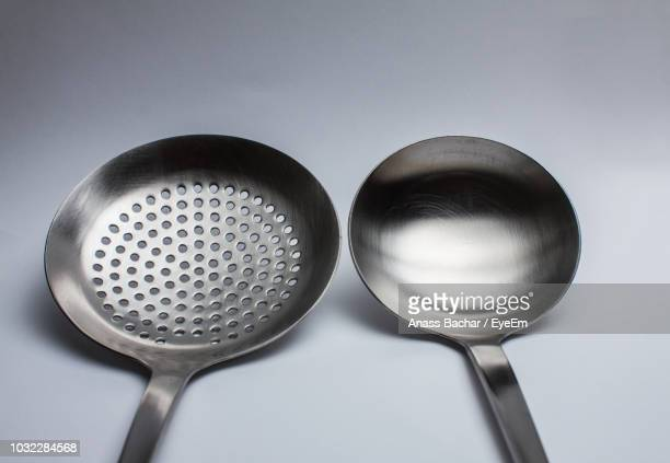 Close-Up Of Cooking Utensils Over White Background