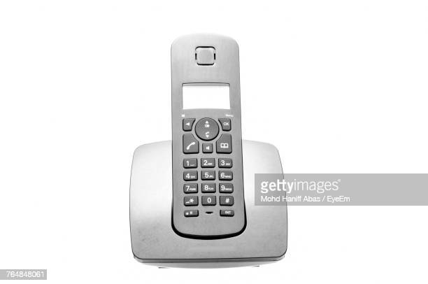 Close-Up Of Cordless Phone Against White Background