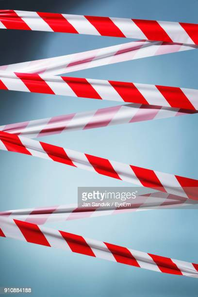close-up of cordon tape against gray background - cordon tape stock pictures, royalty-free photos & images