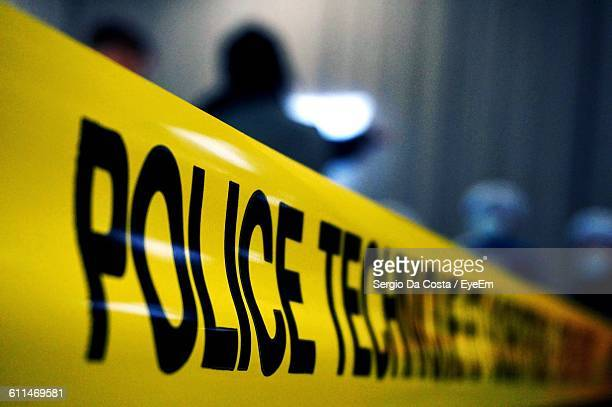 close-up of cordon tape at crime scene - cordon tape stock pictures, royalty-free photos & images
