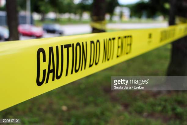 close-up of cordon tape at park - cordon tape stock pictures, royalty-free photos & images