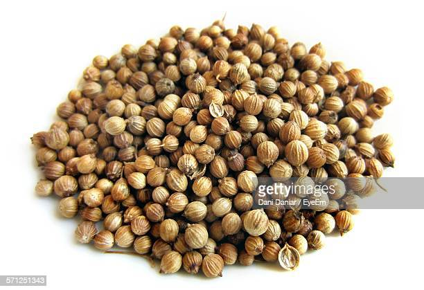 Close-Up Of Coriander Seeds Against White Background