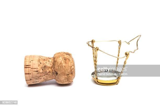 close-up of cork and metal against white background - wine cork stock photos and pictures