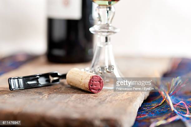 close-up of cork and wineglass on table - cork stopper stock photos and pictures
