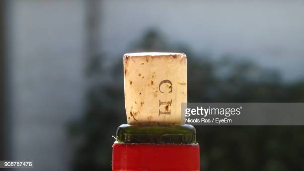 close-up of cork on bottle - wine cork stock photos and pictures