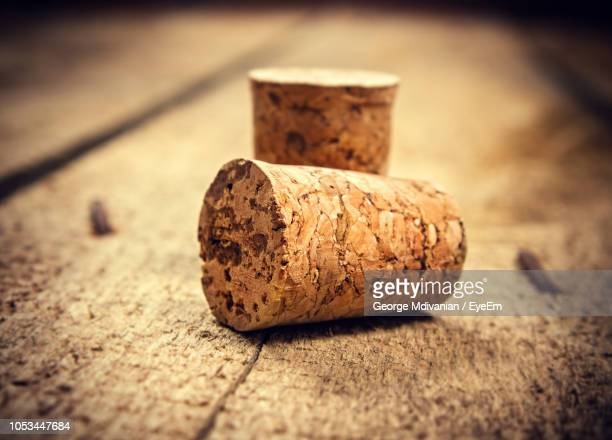 close-up of cork stopper on table - cork stopper stock photos and pictures