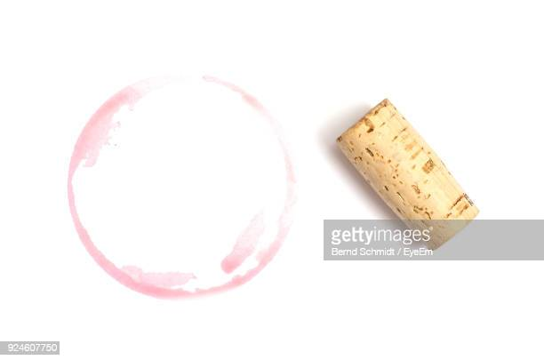 close-up of cork with stain on white background - wine cork stock photos and pictures