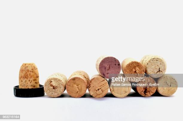 close-up of corks against white background - cork material stock photos and pictures