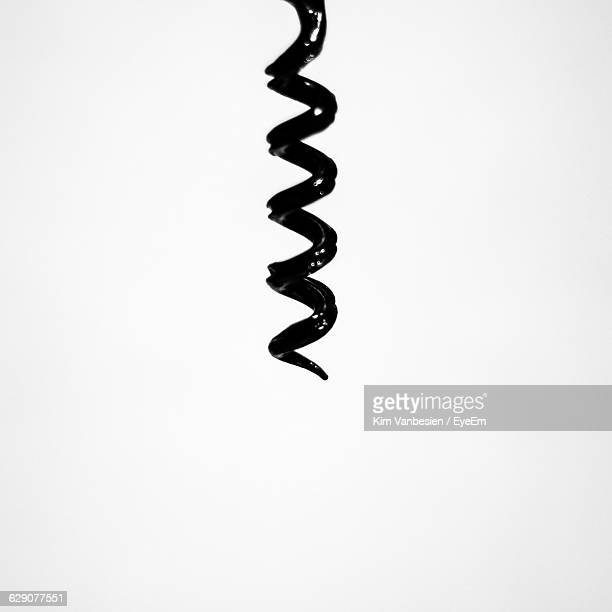 Close-Up Of Corkscrew Against White Background