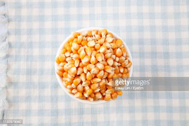 Close-Up Of Corn Kernels In Bowl On Tablecloth