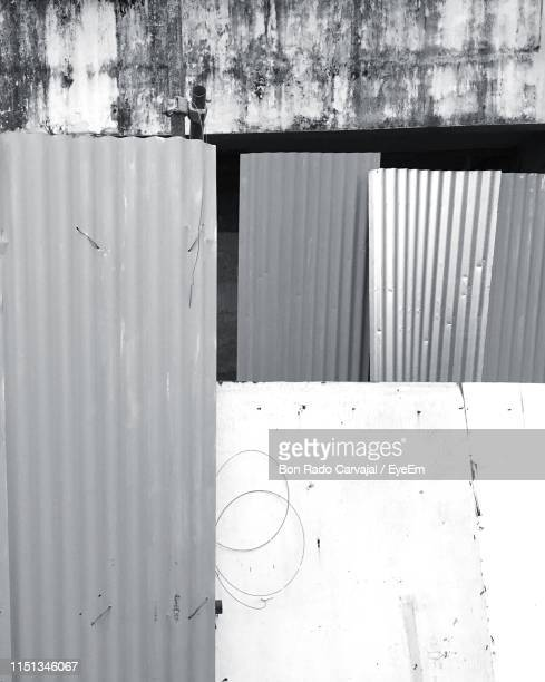 close-up of corrugated iron against wall - carvajal stock photos and pictures