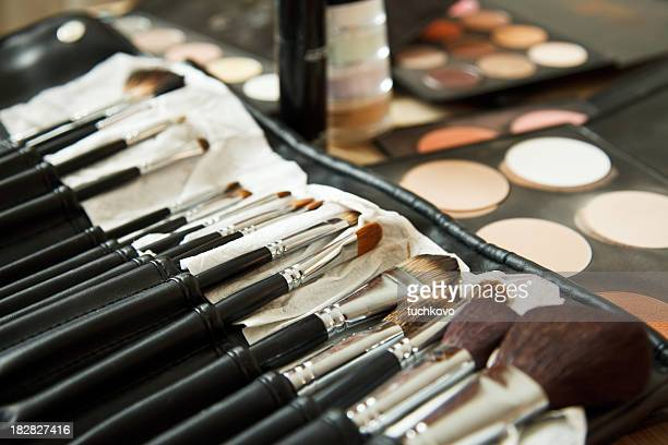 Close-up of cosmetics and make up brushes