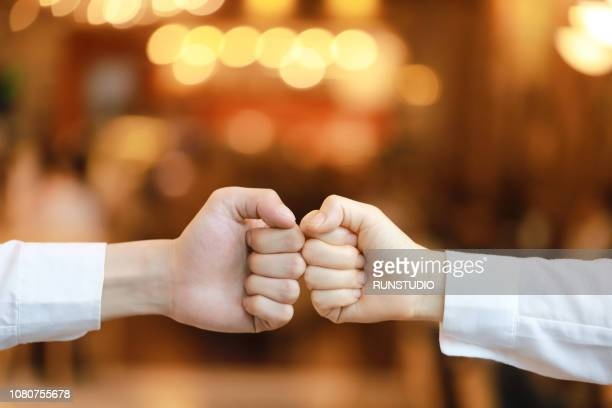 Close-Up Of Couple Bumping Fists