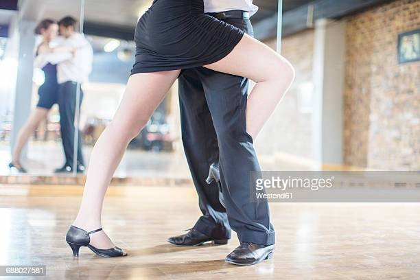 Close-up of couple dancing salsa in studio