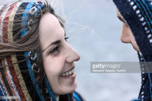 Close-Up Of Couple Face To Face Standing Outdoors