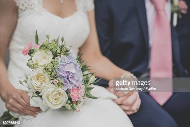 Close-Up Of Couple Holding Flower