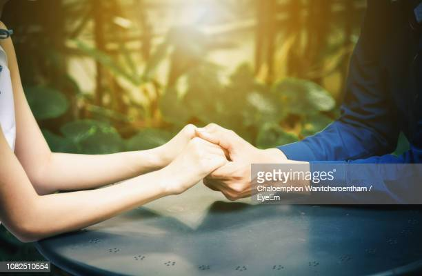 60 Top Holding Hands And Table Pictures, Photos, & Images