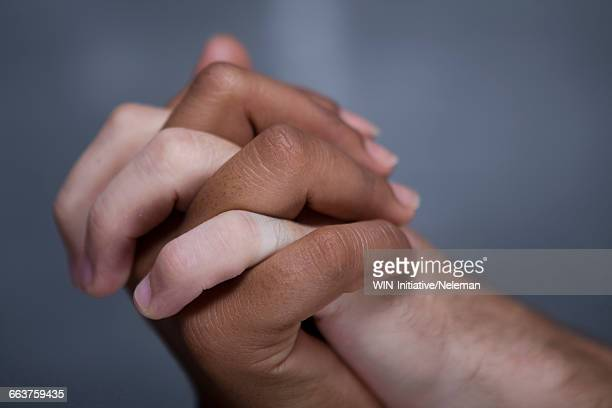 close-up of couple holding hands - hands clasped stock pictures, royalty-free photos & images