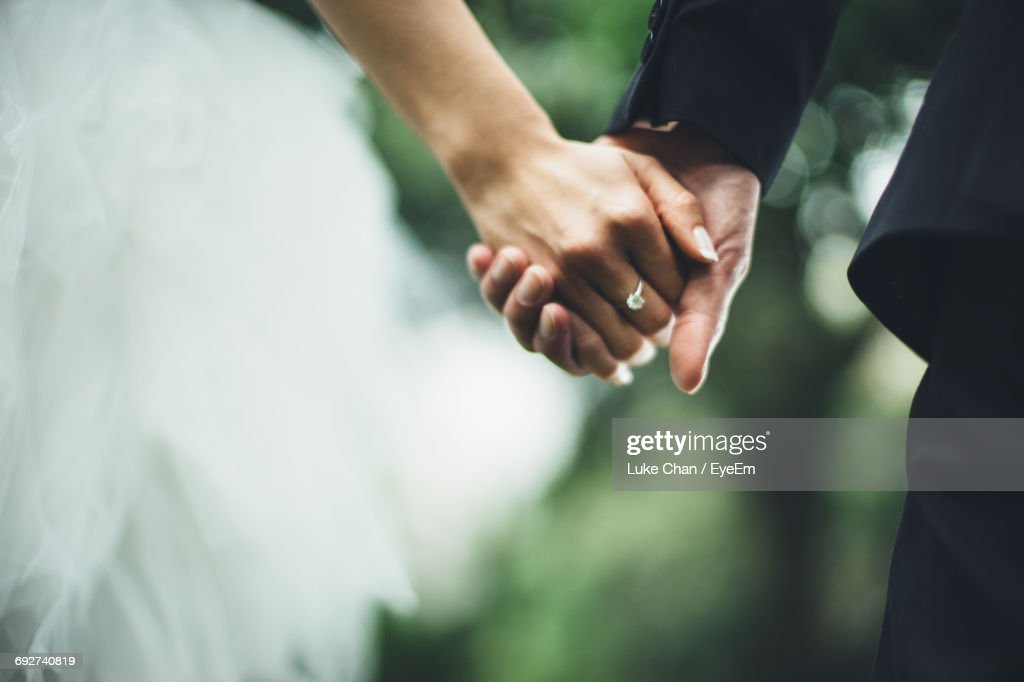 Close-Up Of Couple Holding Hands : Stock Photo