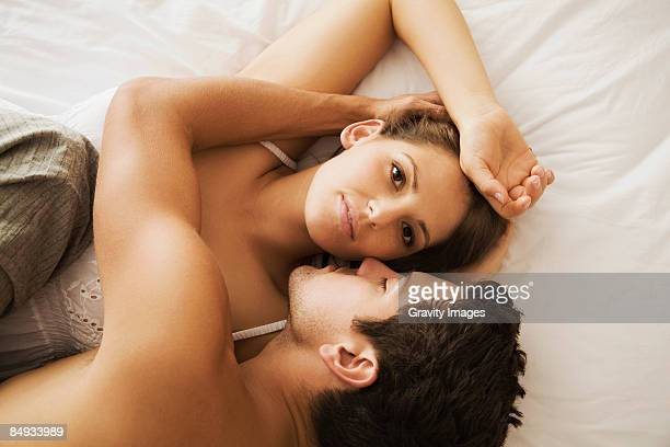 close-up of couple in bed, view from above - girlfriend stock pictures, royalty-free photos & images
