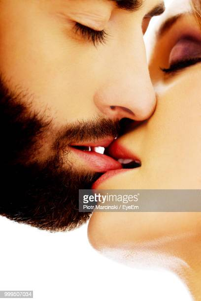 Close-Up Of Couple Kissing Against White Background
