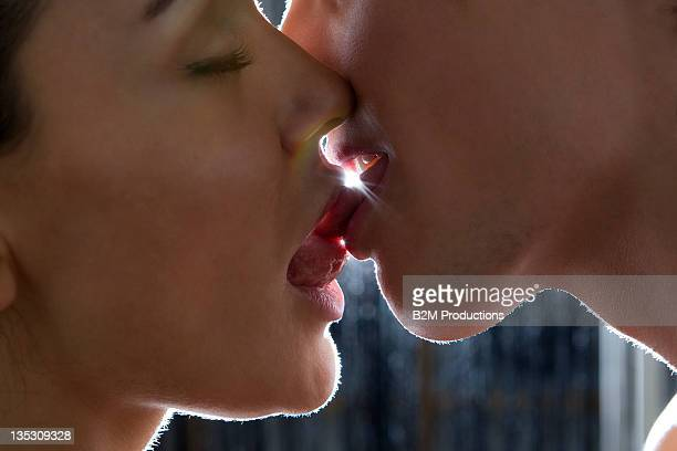 close-up of couple kissing - bacio sulla bocca foto e immagini stock